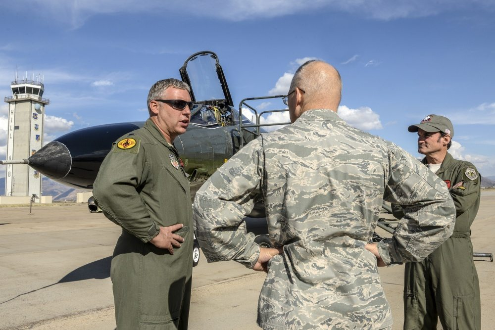 Lt. Col. Ron King, left, and Jim Harkins, both pilots from the 82nd Aerial Targets Squadron, Detachment 1, Holloman Air Force Base, New Mexico, talk with Col. Dana Pelletier, 75th Mission Support Group commander, during a QF-4 Aerial Target aircraft static display at Hill AFB, Oct. 25. (U.S. Air Force photo by Paul Holcomb)