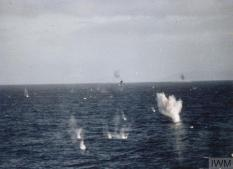 THE FALKLANDS CONFLICT, APRIL - JUNE 1982 (FKD 1256) A head on view from HMS BROADSWORD of two Argentine A4-B Skyhawks (piloted by Capitan Pablo Carballo and Teniente Carlos Rinke of V Air Brigade) as they fly through a hail of anti aircraft fire to attack the Ship north of Pebble Island on the afternoon of 25 May 1982. During this attack (which also resulted in the sinking of HMS COVENTRY), a bomb passed through the starboard stern of HMS BROADSWOR... Copyright: © IWM. Original Source: http://www.iwm.org.uk/collections/item/object/205018853