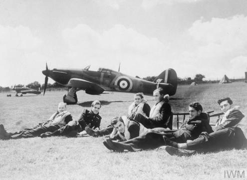 THE BATTLE OF BRITAIN, JULY-OCTOBER 1940 (HU 54418) Pilots of 'B' Flight, No. 32 Squadron relax on the grass at RAF Hawkinge in front of Hurricane Mk I P3522, GZ-V. From left to right: Pilot Officer R F Smythe; Pilot Officer K R Gillman; Pilot Officer J E Procter; Flight Lieutenant P M Brothers; Pilot Officer D H Grice; Pilot Officer P M Gardner and Pilot Officer A F Eckford. All survived the war except Keith Gillman who was posted missing 25 Augu... Copyright: © IWM. Original Source: http://www.iwm.org.uk/collections/item/object/205059622