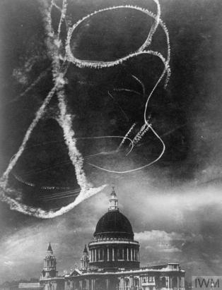 THE LONDON BLITZ 1940 (HU 54557) Composite photograph of St Paul's Cathedral with vapour trails above it, purporting to show a scene during the Battle of Britain. Copyright: © IWM. Original Source: http://www.iwm.org.uk/collections/item/object/205124254