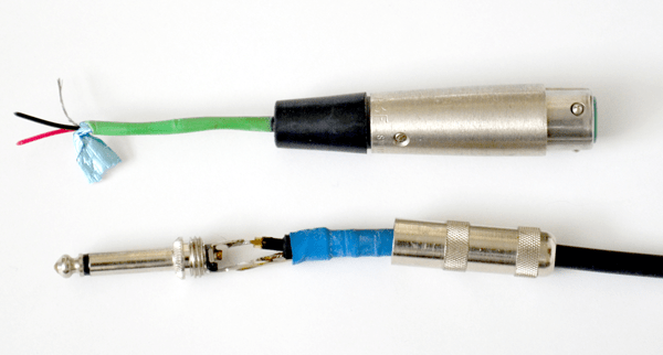 A balanced XLR cable (above) showing its two signal wires and its ground (with a foil shield) compared with a typical 2-conductor TS guitar cable (below).