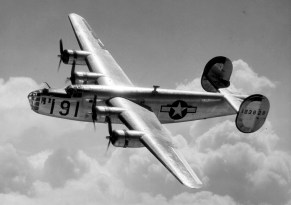 A Consolidated B-24 Liberator from Maxwell Field, Alabama, four engine pilot school, glistens in the sun as it makes a turn at high altitude in the clouds. Heavy Bombers