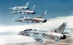 Formation of four F-100Cs (S/N 54-2105, 54-2102, 54-2107, 54-1796). (U.S. Air Force photo)