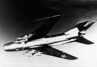 A left underside view of a Soviet MiG-19 aircraft.