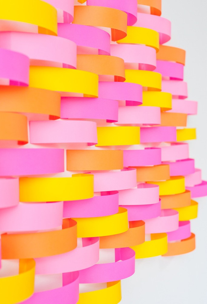 Coloured paper stuck to wall for backdrop idea for party