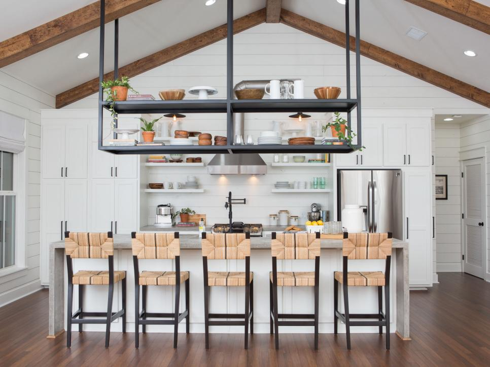 Shiplap industrial modern farmhouse kitchen with vaulted ceilings and timber beams