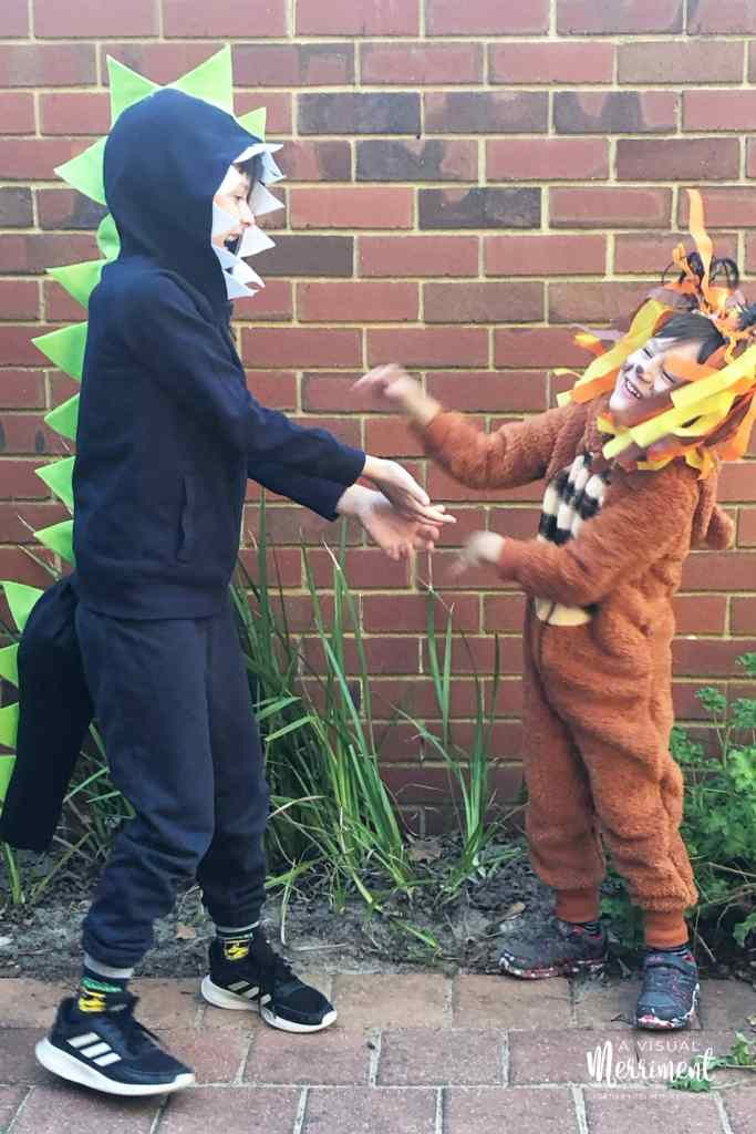 kids in dinosaur and cranky bear costumes