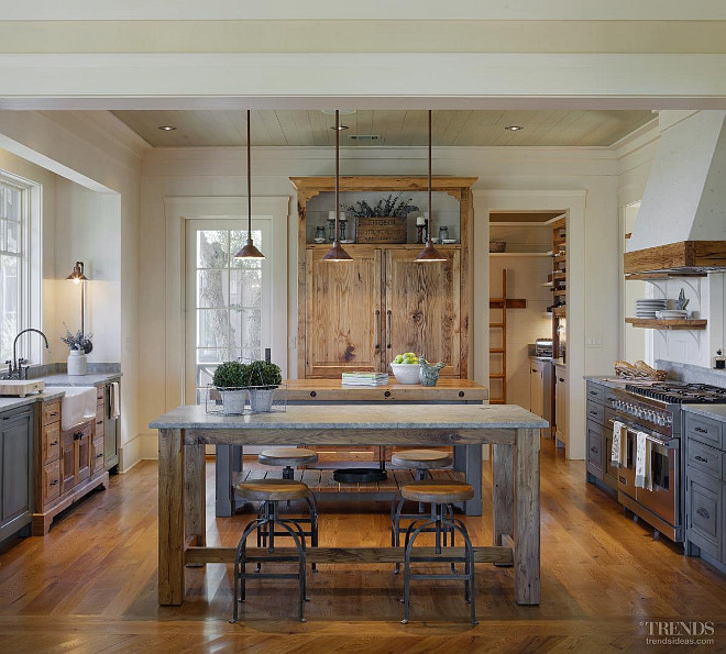 Farmhouse kitchen with timber charm, distressed cabinets., range and traditional sink