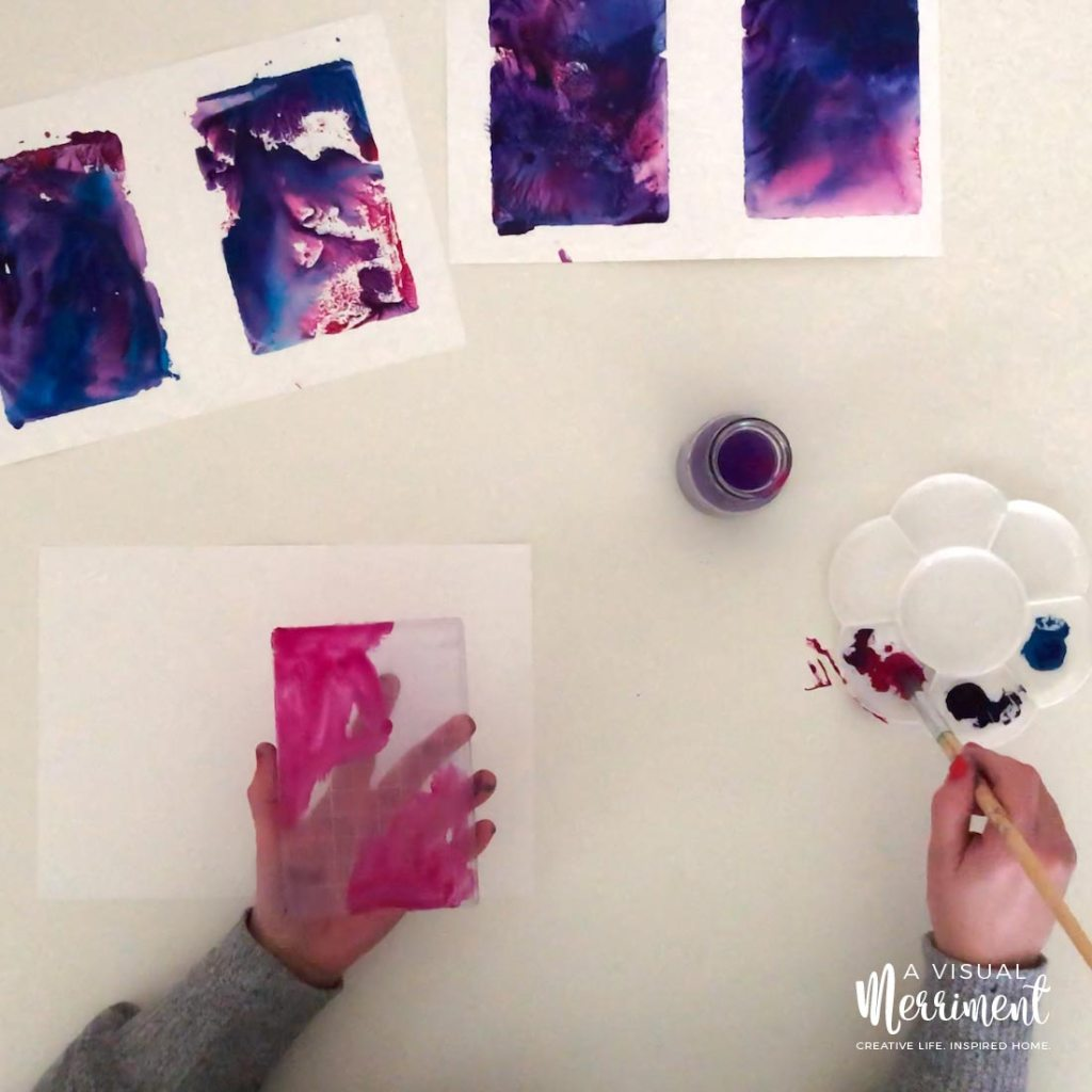 painting pink paint onto stamping block