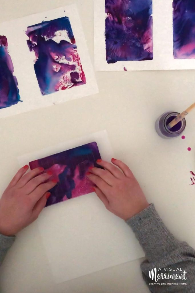 Pressing down painted acrylic block onto paper