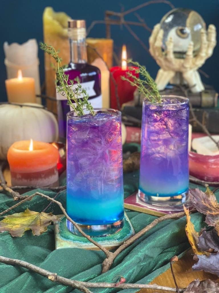 Spooky Halloween scene with blue and purple drinks
