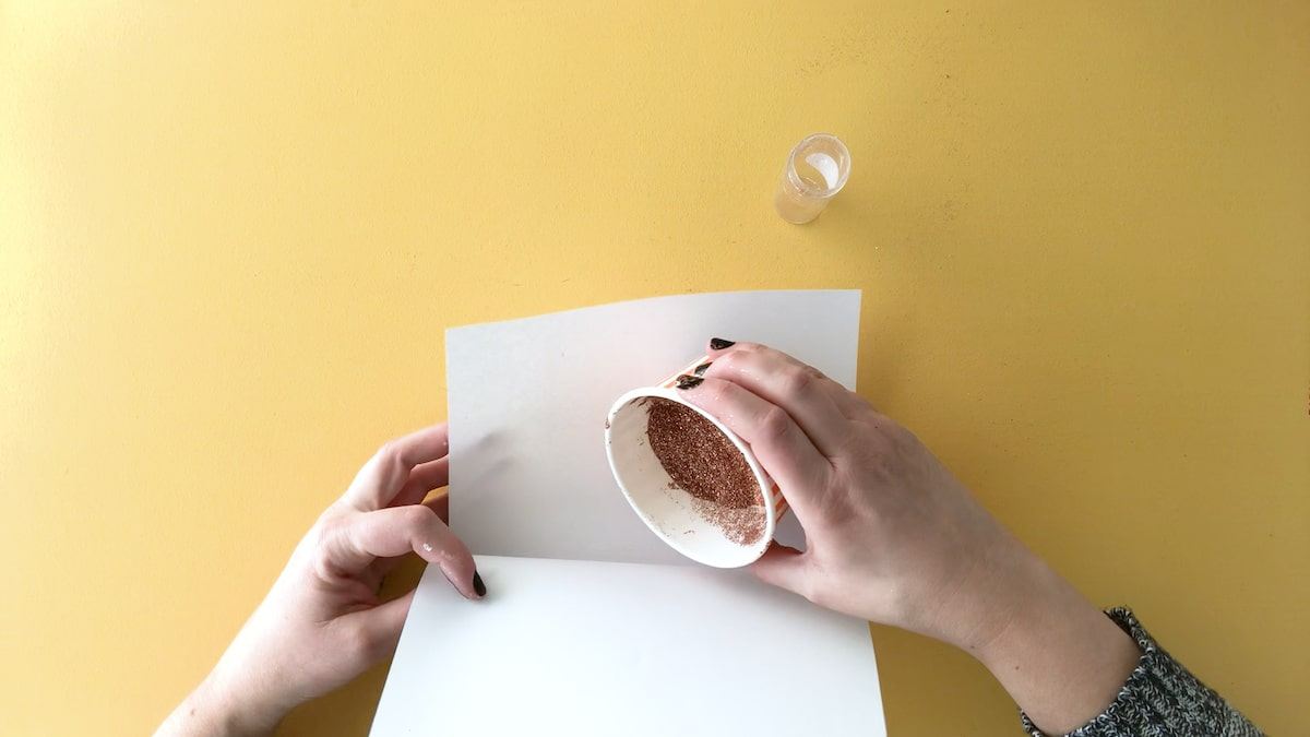 Clean glitter by emptying onto folded paper