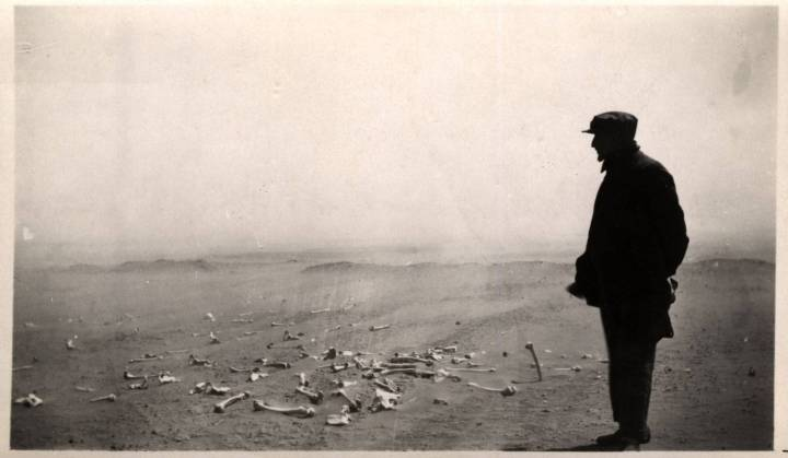 Armenian looking at the human remains of the terrible massacres at Der el Zor in 1915 1916. AGMI_2