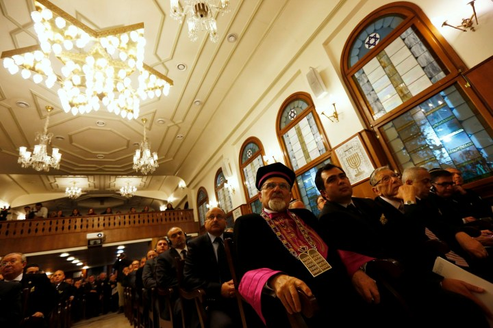 Members of Turkey's Jewish community gather at Etz Ahayim Synagogue to commemorate International Holocaust Remembrance Day in Istanbul January 27, 2013. The International Day of Commemoration, which was designated by the United Nations General Assembly to honour Holocaust victims, occurs annually on January 27. REUTERS/Murad Sezer (TURKEY - Tags: POLITICS RELIGION ANNIVERSARY)