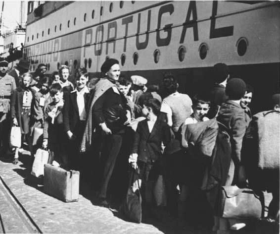 Lisbon, 10 June 1941.  A group of Jewish refugees wait in line to board a ship to the United States.  Photo courtesy of the US Holocaust Memorial Museum