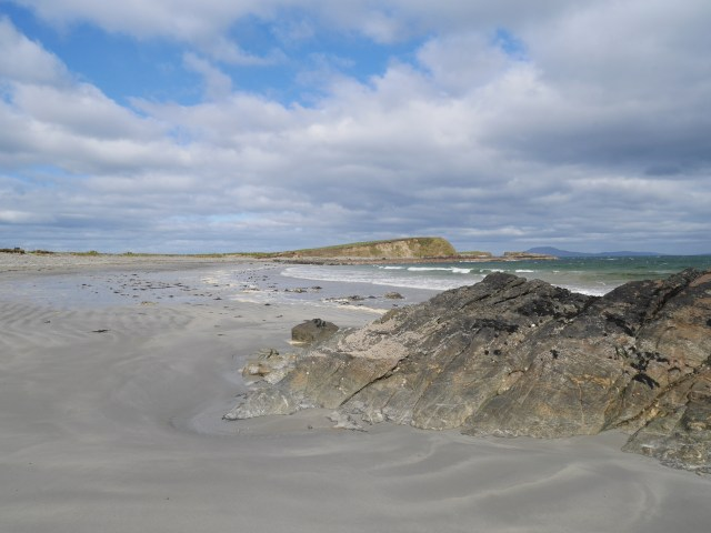 Tully beach - the headland leads to the white strand