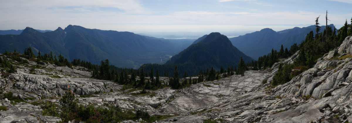 View from Coliseum mountain. Mount Elsay & Mount Seymour (left) The needles & Lynn Peak (middle), Mount Fromme & Grouse Mountain (right)