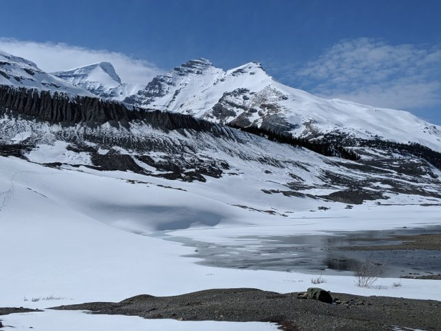 Lakes, moraine and snow by the Athasca Glacier