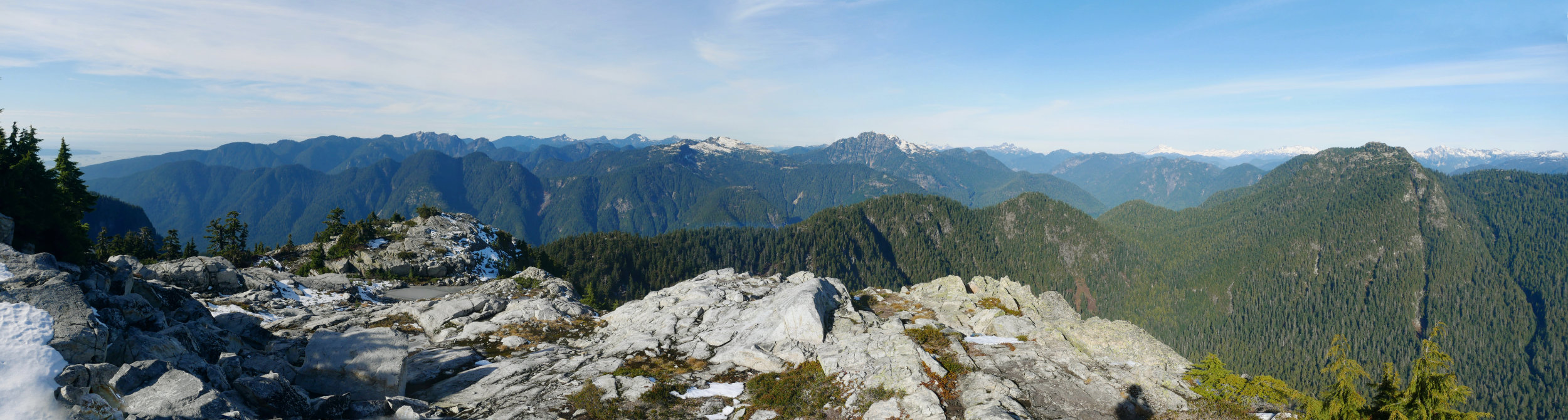 Looking West from Mount Elsay. The first line of Mountains is the Vicar's ridge. Behind that is Lynn Peak, Needles, Coliseum to Cathedral Mountain. Behind that are Grouse, Crown etc. Beyond that are the Mountains on the Sea to Sky Highway, like the Lions and Unnecessary Mountain