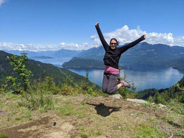 Jumping above Harrison Lake