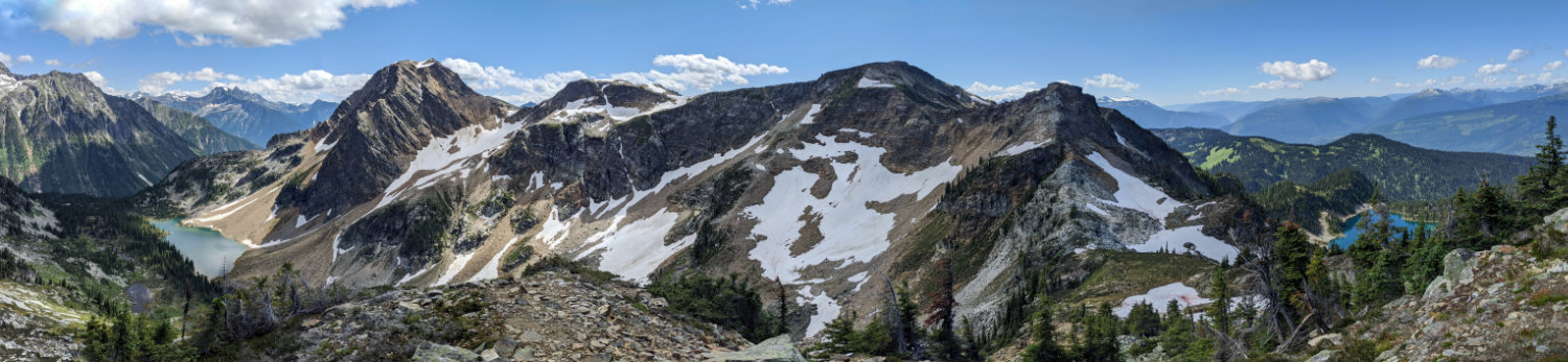 and the starting point off in the distance (the tree covered ridge above Miller Lake)