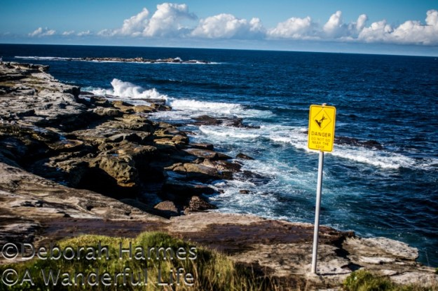 Danger sign on the clifftop walk to Coogee Beach in Sydney, Australia