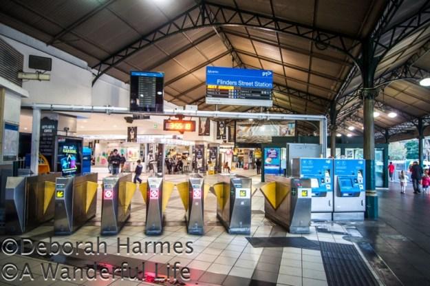 Turnstiles inside the Flinders Street Station in Melbourne, Australia