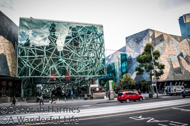 Reflection of the lovely and old Forum Theatre into the starkly new and modern glass facade of Federation Square in Melbourne, Australia