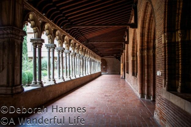 Cloistered walkways surround the garden courtyard.