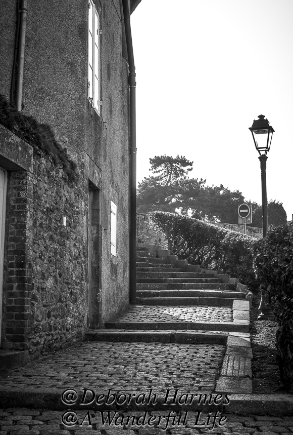 Up the stairs in Granville, a historic seaside town in Normandy, and into the fog at the top of the stairs.