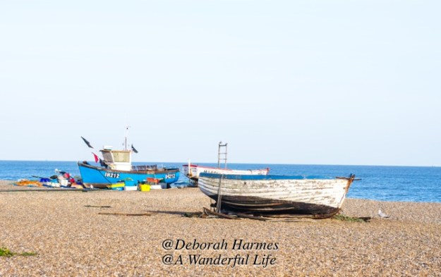 Fishing boats on a gravel, sometimes called shingle, beach in the UK.