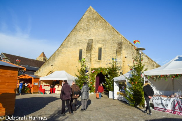 The heart of the Marche de Noel (Christmas Fair) in Saint-Pierre-sur-Dives in the Calvados region of Normandy, France is the medieval market hall in the centre of town.
