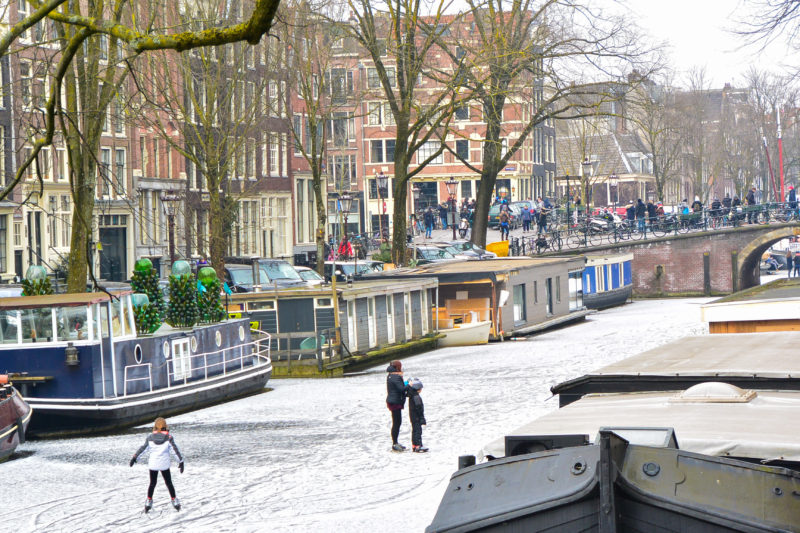 Houseboats in a frozen Amsterdam canal