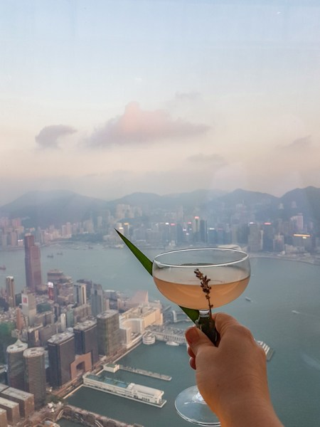 Having a drink at the OZONE with a view of Hong Kong island