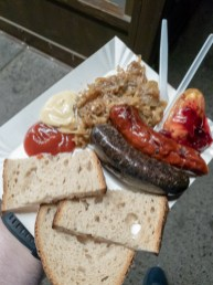 Street Food plate (two types of sausages, caramelized onions, and smoked cheese with cranberry) -- Haha Grill Kazimierzu, Krakow