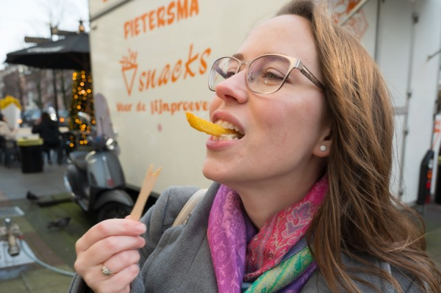 Jess with fries at the Albert Cuyp market