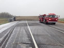 A semi-truck blown by strong winds blocking the Trans-Canada Highway into Portage la Prairie.