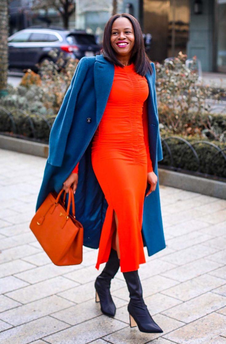 Atlanta Fashion blogger wearing an orange midi dress, orange Prada tote, black boots, and blue coat. Hair by Wella Hair USA -2