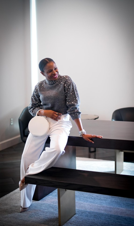 Atlanta fashion blogger wearing grey crop sweater with pearl details and white wide-leg pants. white circle bag and valentino rockstuds. Cold weather glam-7