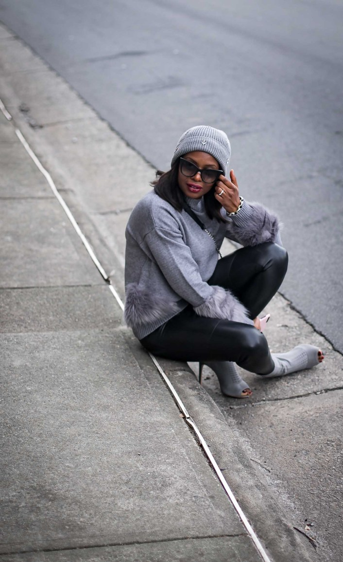Atlanta fashion blogger wearing leather leggings, grey sweater with fur details and grey sock booties.-14