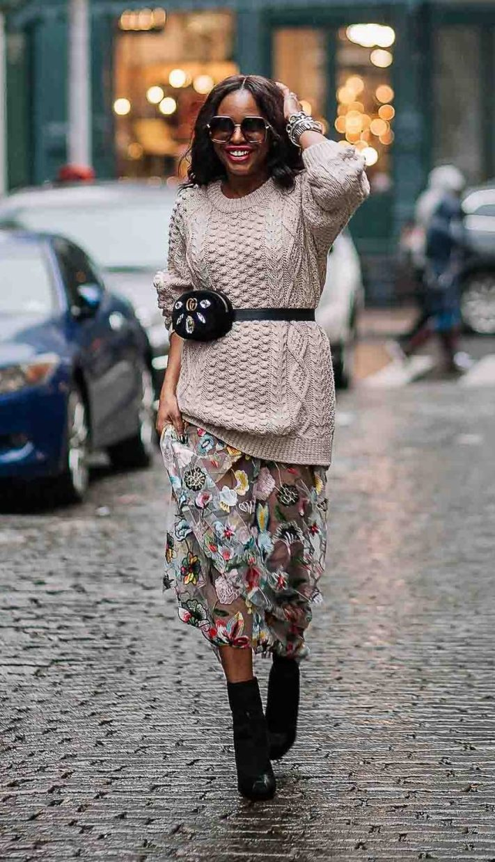 Chunky beige sweater worn with long floral dress, gucci waist bag, gucci square sunglasses, and black booties worn by Atlanta Fashion blogger. Influencer-3