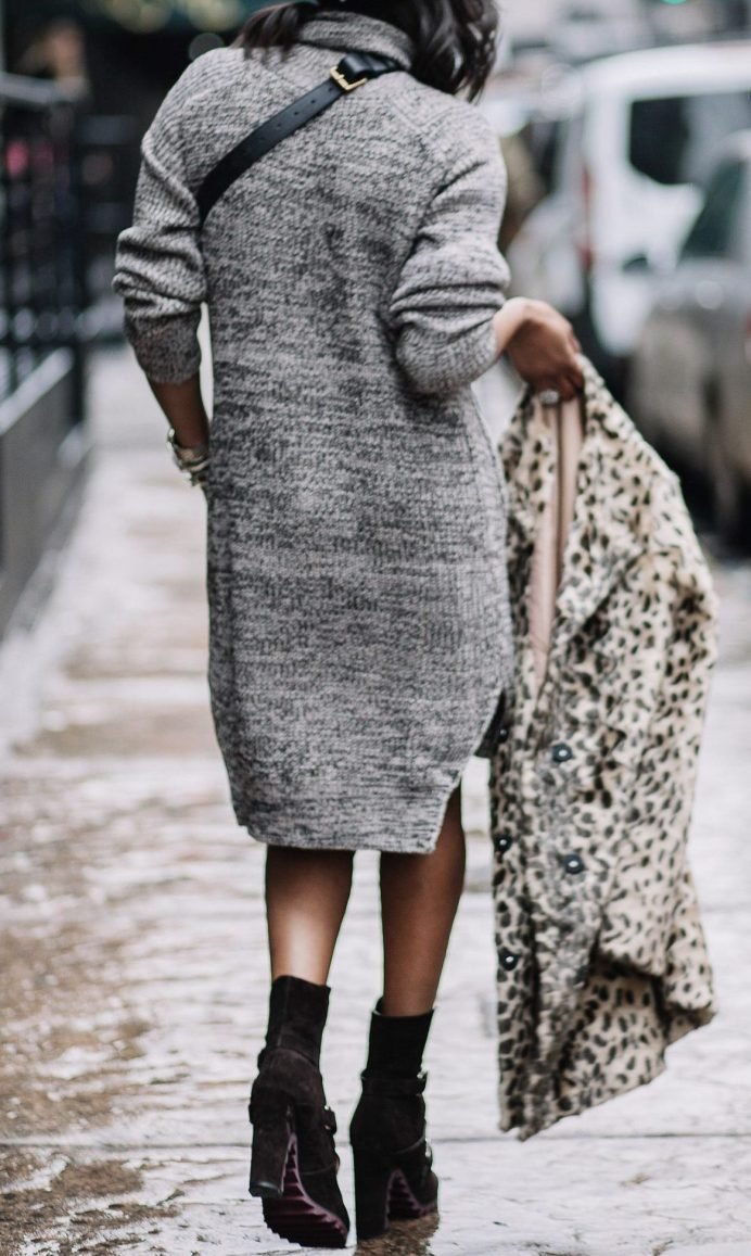 Fashion blogger wearing sweater dress with gucci waist bag and gucci sunglasses during NYFW22