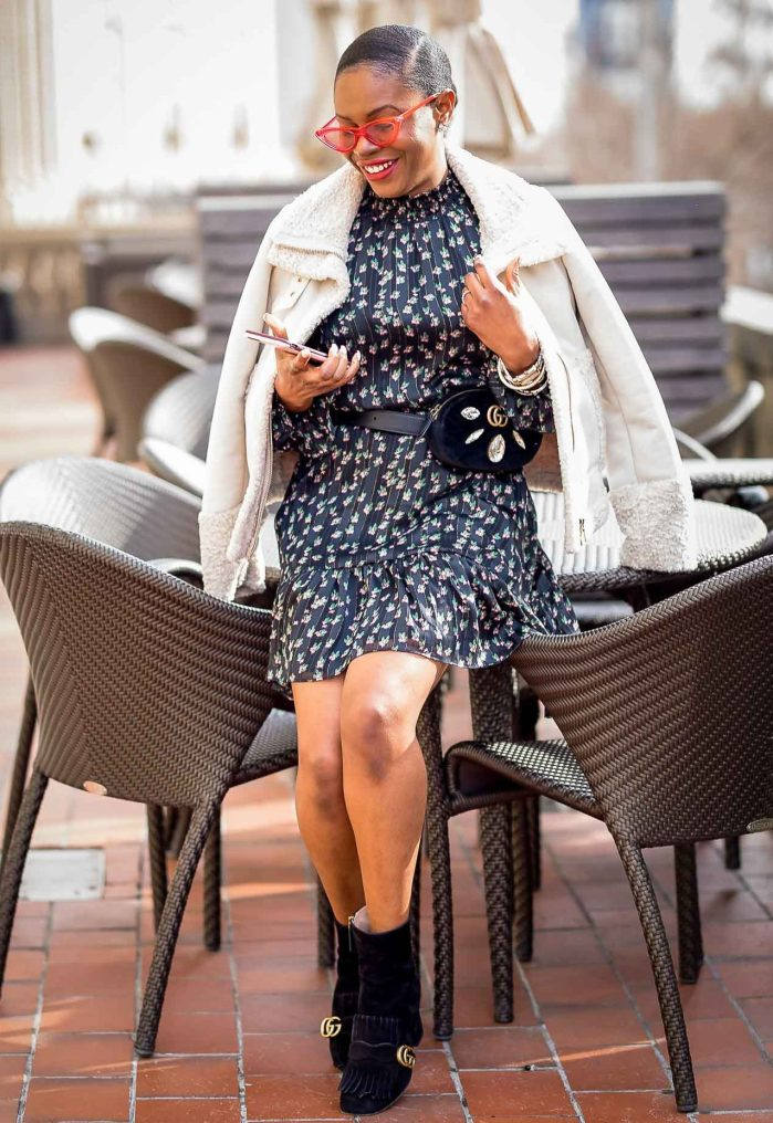 how to style a floral mini dress in the winter. floral dress worn with gucci suede booties, gucci waist bag and le spec sunglasses-5