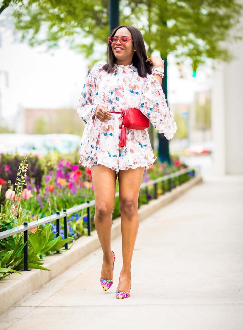 how to wear a floral romper during the spring summer. jumpsuit worn with floral pumps by manolo blahnik, red ysl belt bag, and lespac cat eye sunglasses-10