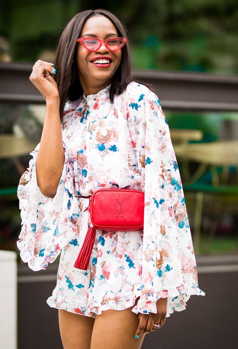 how to wear a floral romper during the spring summer. jumpsuit worn with floral pumps by manolo blahnik, red ysl belt bag, and lespac cat eye sunglasses-7