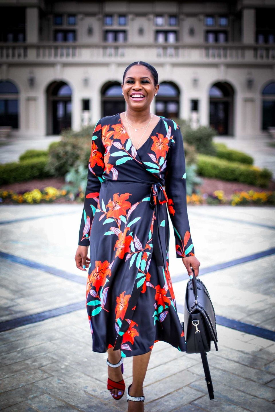 Atlanta fashion and lifestyle blogger wearing DVF wrap dress. Wrap dress featuring floral silk print. Also wearing miu miu platform sandals and henri bendel lux bag-11