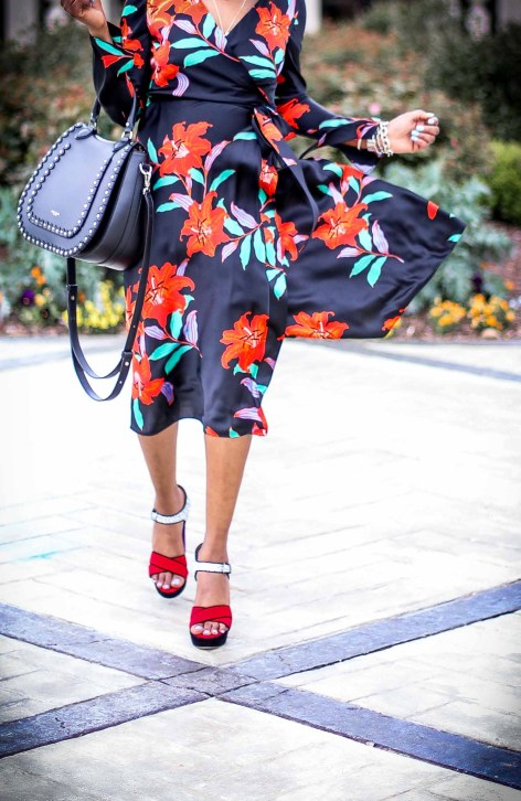 Atlanta fashion and lifestyle blogger wearing DVF wrap dress. Wrap dress featuring floral silk print. Also wearing miu miu platform sandals and henri bendel lux bag-9