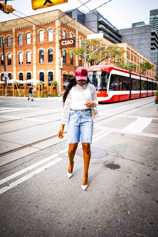 Atlanta fashion and lifestyle blogger wearing denim bermuda shorts from, leather baseball cap, white lace tops, and white pumps-19