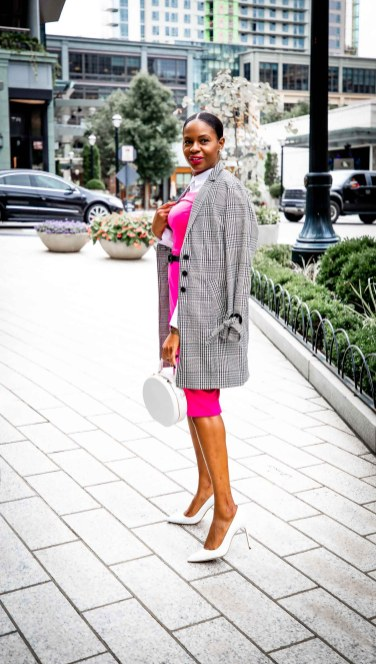 Fashion blogger Monica Awe-Etuk wearing a pink dress and plaid jacket from stage in celebration of breast cancer awareness month-3