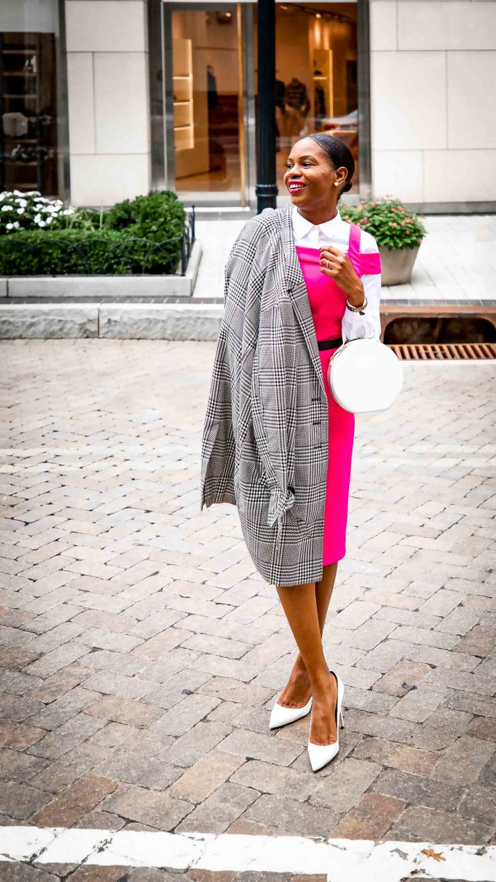 Fashion blogger Monica Awe-Etuk wearing a pink dress and plaid jacket from stage in celebration of breast cancer awareness month-7